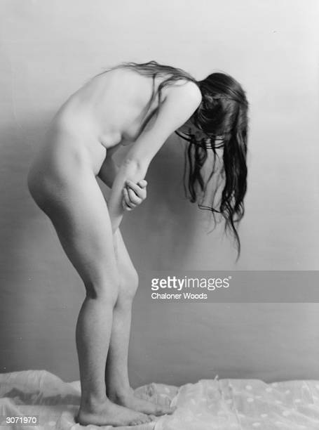 The photographer's model arches her back and retreats