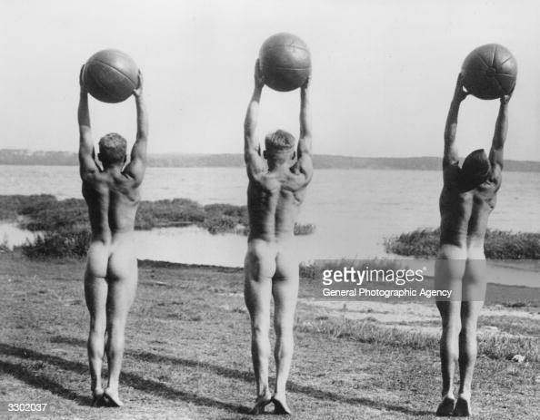 nude boys holding balls