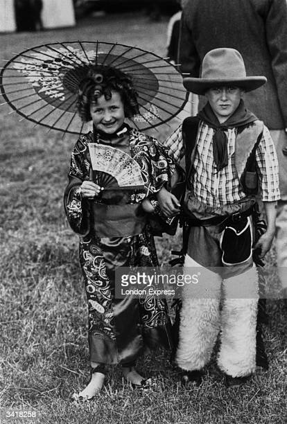 Two of the first prize winners in the children's fancy dress parade in aid of the King George Hospital in Ilford, Essex. The girl has come as Shirley...