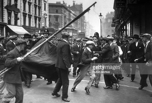 A skirmish which broke out between police and some unemployed demonstrators in High Holborn London during an attempted march to Bow Street police...