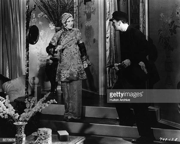 American actors Jean Arthur and Neil Hamilton in an action scene from the film 'The Insidious Dr Fu Manchu' Title The Insidious Dr Fu Manchu Studio...