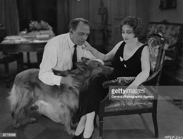 American actress Pauline Frederick with her dog and the director of 'Mrs Paranor' during a break in the MGM film which is adapted from the novel by...