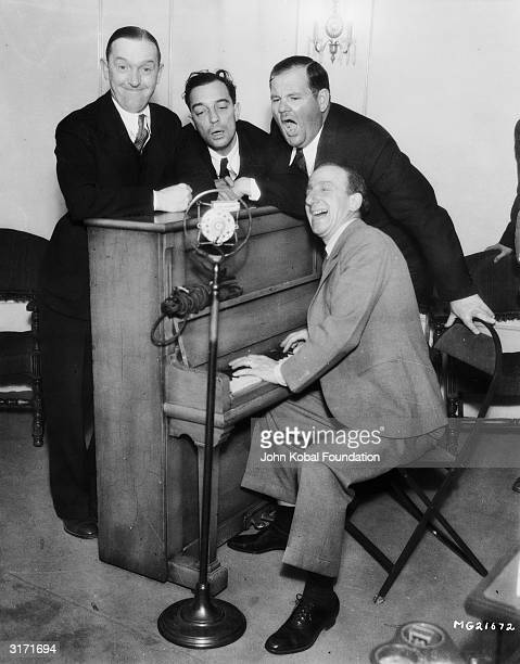 American silent screen comedian and actor Buster Keaton with fellow comedians Jimmy Durante Stan Laurel and Oliver Hardy