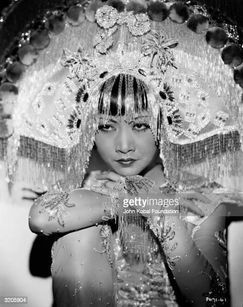 ChineseAmerican film star Anna May Wong wearing an outlandish headdress