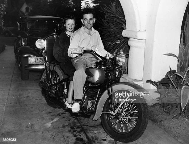 French actress Simone Simon rides pillion on a motorbike behind director William Wyler The bike was given to Wyler by actress Margaret Sullivan