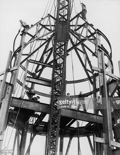 Group of men on the steel framework of the mooring mast of the Empire State Building during its construction New York City