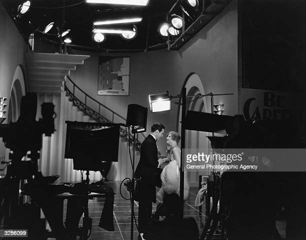 Joan Crawford and Johnny Mack Brown film a scene for the MGM production 'The Dancing Girl' which was the first film to make exclusive use of the...