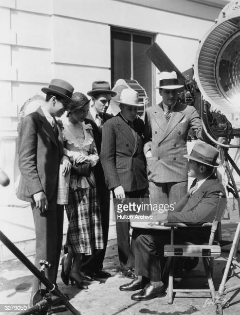 Lilyan Tashman the American silent screen actress prepares for a scene in the film 'Up Pops The Devil' She stands by Edward Nugent Skeets Gallagher...