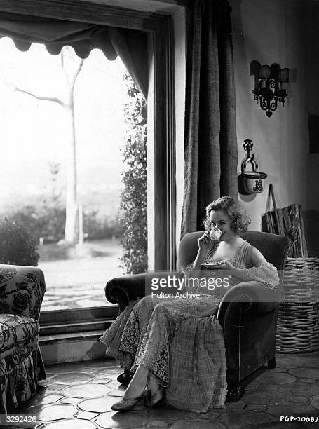 Miriam Hopkins the dynamic and dramatic blonde who is contracted to Paramount is viewed in her new home at Santa Monica having a cup of tea