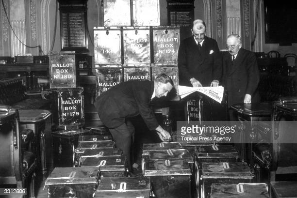 Officials at Camberwell Town Hall London counting and checking ballot boxes in preparation for the General Election On the right is the Mayor of...