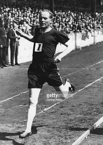 Olympic 5000m and 10,000m champion Paavo Nurmi winning a race at Stamford Bridge Stadium, London.