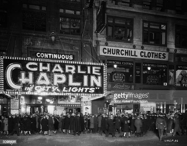 People flock to a cinema to see 'City Lights' the latest Charlie Chaplin film at the George M Cohan Theater on Broadway Times Square New York City