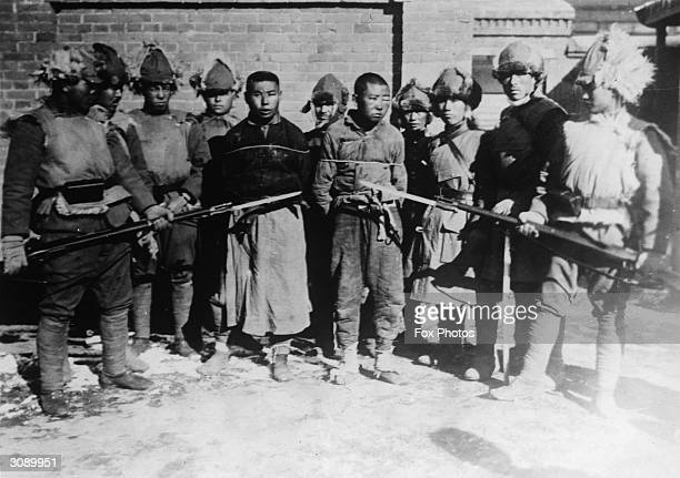 Two prisoners being held captive victims of the war between China and Japan over the Japanese occupation of Manchuria in 1931