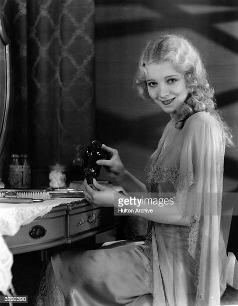 Virginia Bruce the tap dancing Hollywood actress and Paramount player, makes up her eyes.