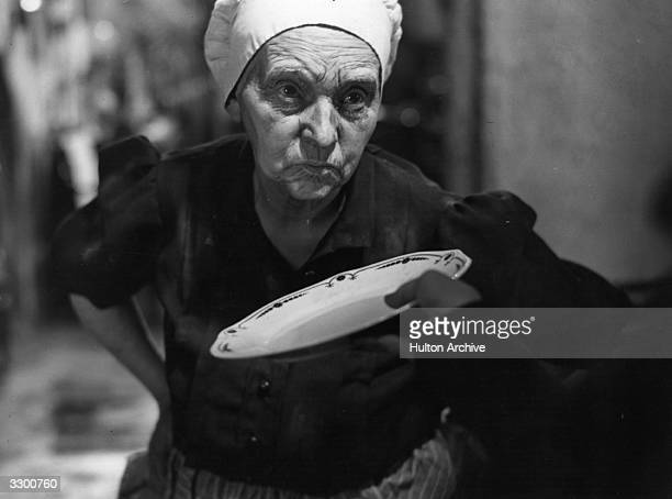 A scene from the French film 'Poil De Carotte' with an old cook ignoring an empty plate The film was directed by Julien Duvivier