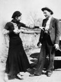 Circa 1932 american criminal bonnie parker aims a shotgun at her picture id3208705?s=170x170