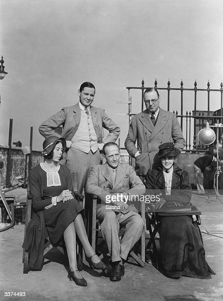 At Islington Studios London during the filming of A A Milne's play 'Michael and Mary' are actor Herbert Marshall and director Victor Saville Sitting...