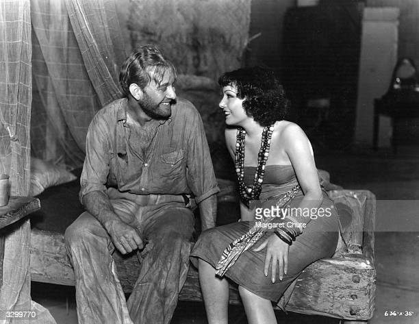 Conrad Nagel and Lupe Velez the screen name of Guadeloupe Velez De Villalobos enjoy a laugh between scenes of the Metro Goldwyn Mayer production of...