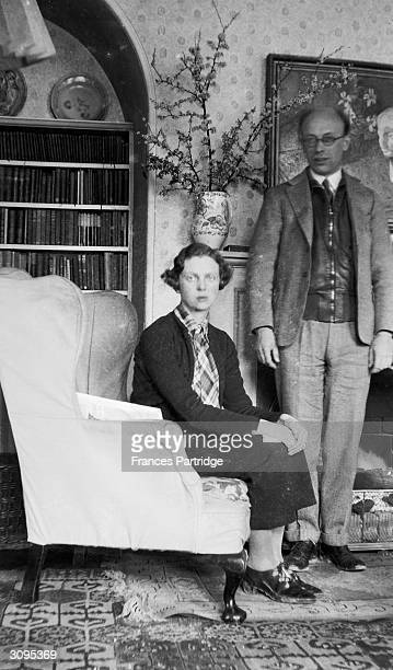 Eddie GathorneHardy and Barbara KerSeymour photographer at Ham Spray Wiltshire home of Frances and Ralph Partridge The painting over the fireplace is...