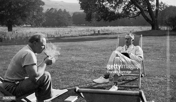 Friends Ralph Partridge and Saxon SydneyTurner on the lawn at Ham Spray Wiltshire the home of Frances and Ralph Partridge