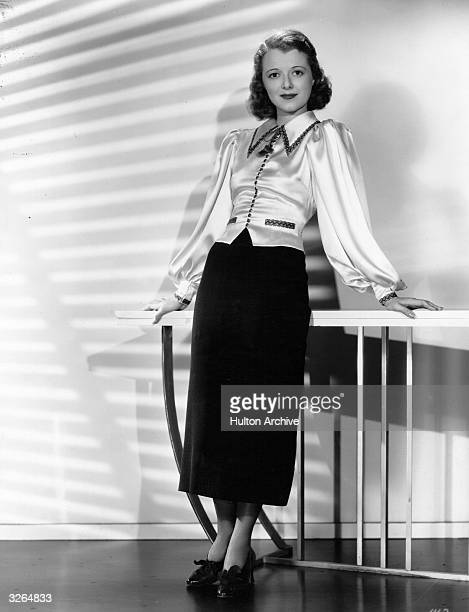 Janet Gaynor the American actress who worked for Fox Films She was married to costume designer Adrian and producer Paul Gregory She is wearing a two...