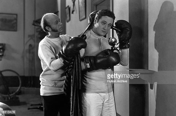 Lucien Littlefield and Edmund Lowe in a scene from the US film 'The Reason Why'
