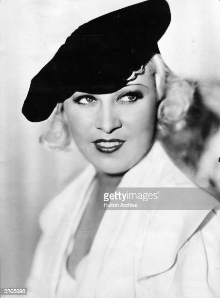 Mae West in her prime, an American leading lady and the archetypal sex symbol who was vulgar, mocking, overdressed and endearing. She wrote her own...