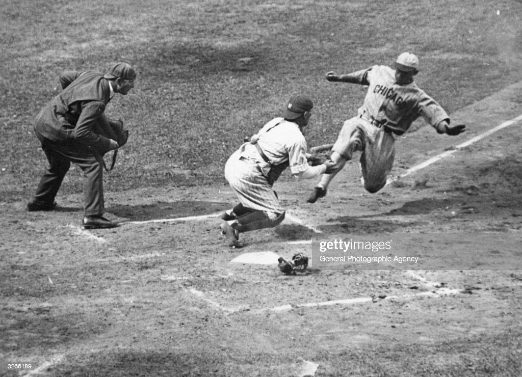 Metzler (right) of the Chicago White Sox slides in as Pat Collins (centre) the New York Yankee's catcher waits to receive the ball, with umpire Gersel looking on.