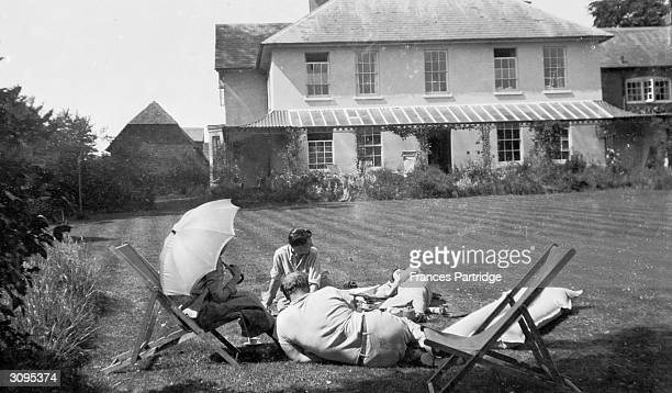 Ralph Partridge and a group taking tea on the lawn at Ham Spray Wiltshire