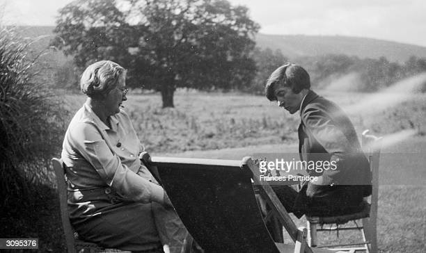 The sisters of Lytton Strachey Marjorie and Alix playing chess in the garden at Ham Spray Wiltshire home of Frances and Ralph Partridge