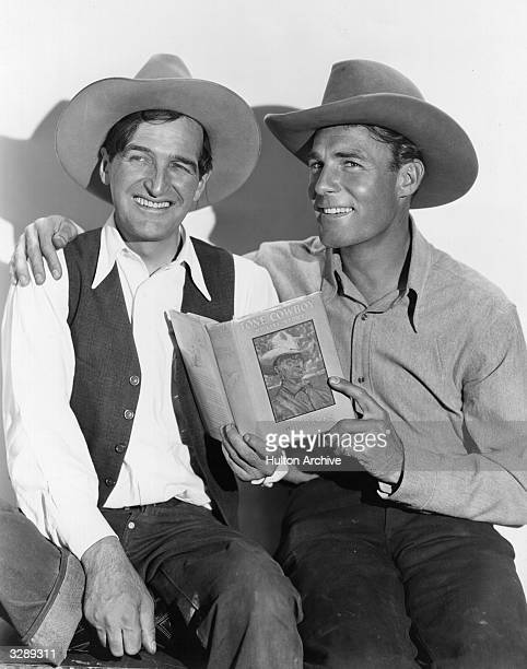 Will James the famous Western character on the left tutors Randolph Scott the stage name of Randolph Crane the American outdoor star in the cowboy...