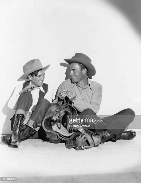 Will James the famous Western character tutors Randolph Scott the American actor in the cowboy art of rolling cigarettes Scott will play the title...