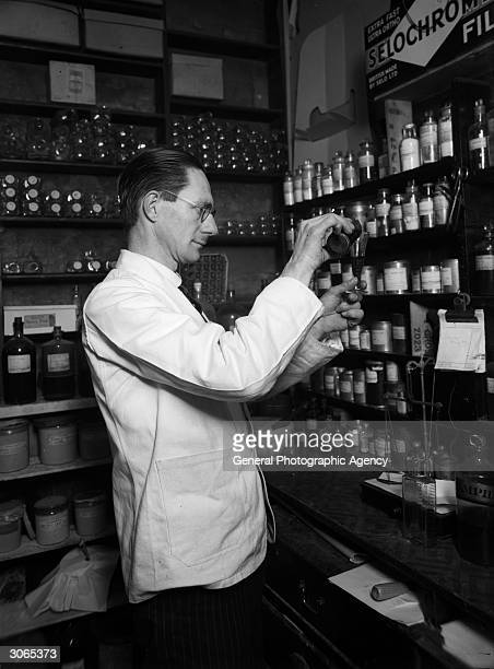 A chemist at work making up a prescription