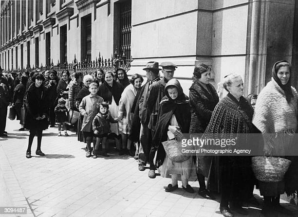 A queue waiting outside a centre in Madrid where bread is either free or sold for a nominal sum