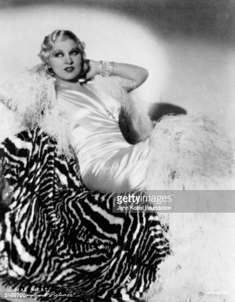 American actress Mae West , the star of such popular films as 'I'm No Angel', 'Klondike Annie' and 'Go West Young Man'. Her brashness and bold use of...