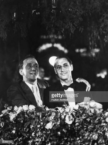 American comic actor Jimmy 'Schnozzle' Durante welcomes Groucho Marx, of the comical Marx Brothers, to the premiere of 'Strange Interlude'.
