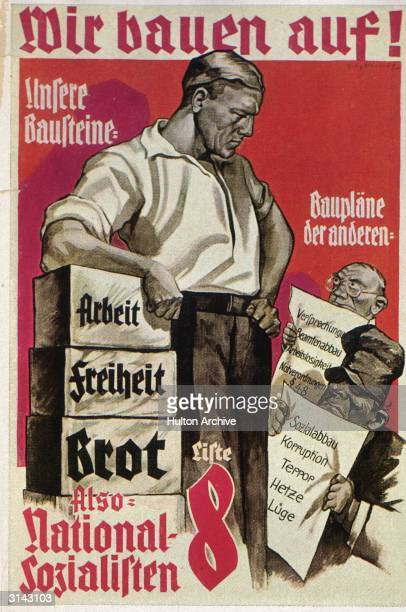 An election poster for the Nazi party headed 'We Are Building ' The poster contrasts the Nazi agenda with those of their rivals who it is claimed...
