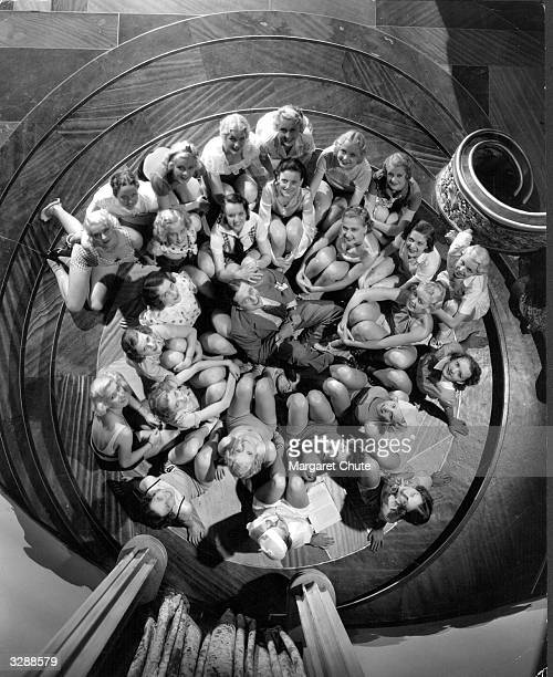 Edmund Lowe the Hollywood actor surrounded by a bevy of young actresses