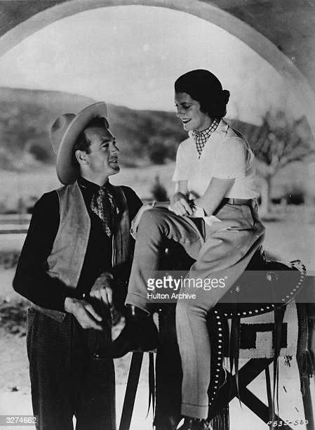 Gary Cooper American film star and his wife actor Sandra Shaw in cowboy attire