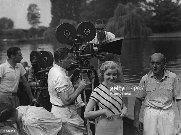 Iris Marsh who stars in the ATP film 'Three Men In A Boat' is with Graham Cutts the director on the extreme right and Bob Milton the chief cameraman