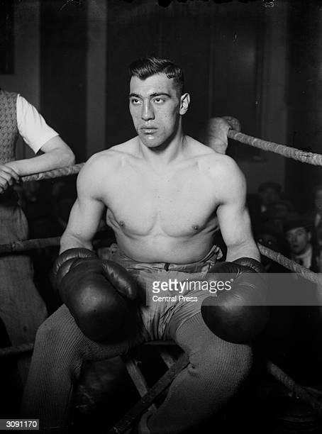 Italian boxer and world heavyweight champion Primo Carnera sitting in the corner between rounds