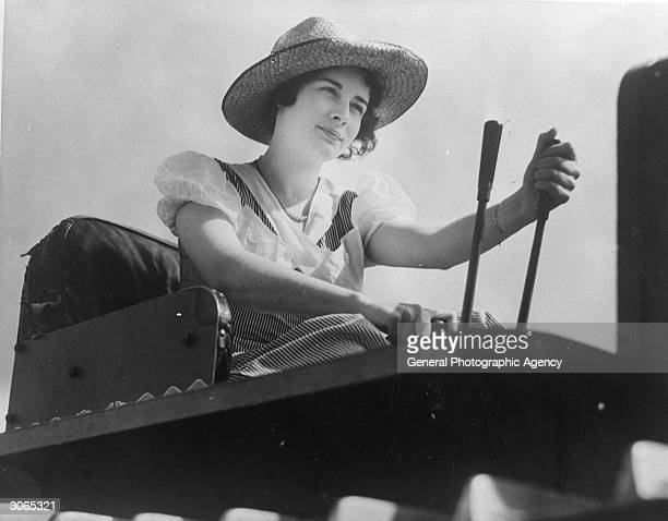 Margaret Campbell of Near Kent Washington drives a tractor on her family's farm