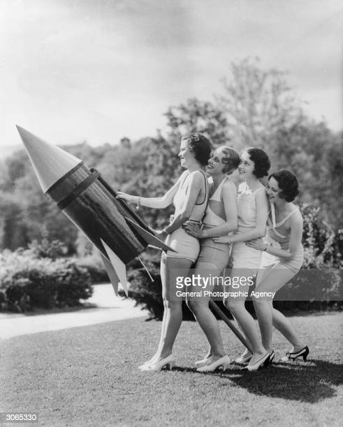 Members of the Greenbriar Amateur Movie Club White Sulphur Springs West Virginia with their rocket for 4th July celebrations L to r Laddie Frechem...