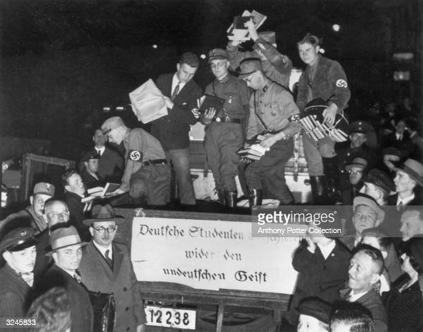 Nazi youth collect 'unGerman' books from the back of a truck that bears a sign which reads 'German students march against the unGerman spirit' Germany