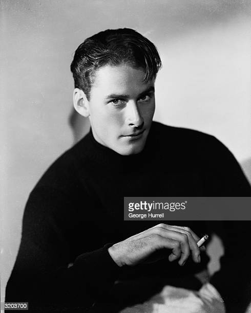 Tasmanian film star Errol Flynn raises a suggestive eyebrow at the camera