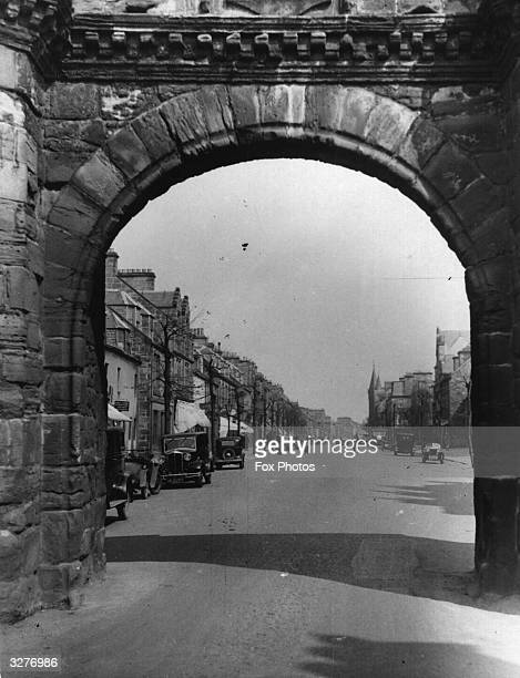 The town of St Andrews in Scotland seen through an old archway The university town of St Andrews is famous for its ruined cathedralthe castle and the...
