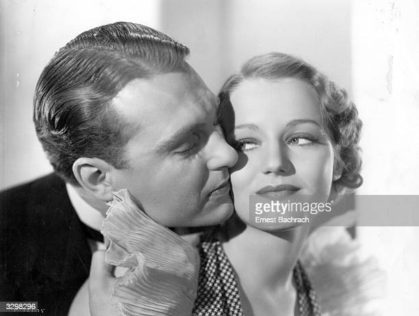 A cheek to cheek embrace between Ralph Bellamy the soft voiced American actor and Constance Cummings the stage name of Constance Halverstadt the...