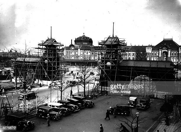 A front view of Tokyo Station with buildings still under construction The 'welcome gate' for the visiting Emperor of the Manchukue is almost complete