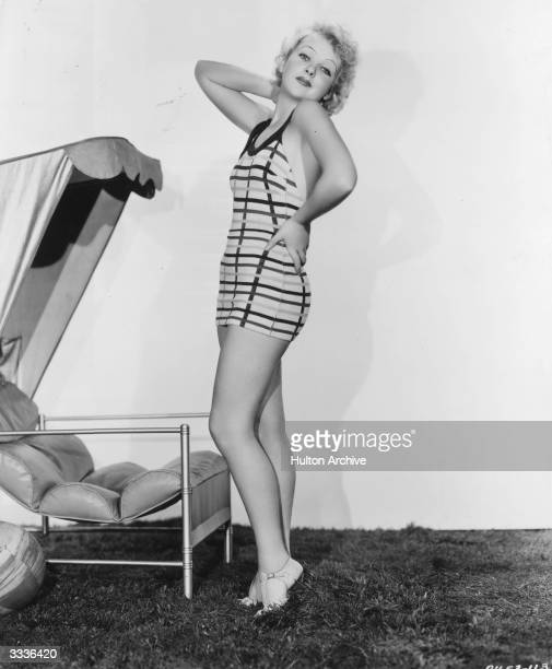 British actress and future film director Ida Lupino standing wearing a bathing suit in a photography studio