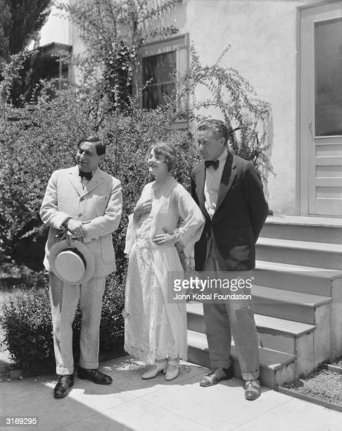 Hollywood directors Ernst Lubitsch and Fred Niblo with Niblo's wife, silent screen star Enid Bennett .